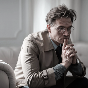 A man looks pensive as he feels stress and anxiety